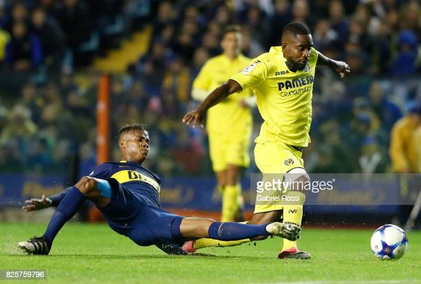Cedric Bakambu of Villarreal CF fights the ball with Wilmar Barrios of Boca Juniors during the international friendly match between Boca Juniors and...