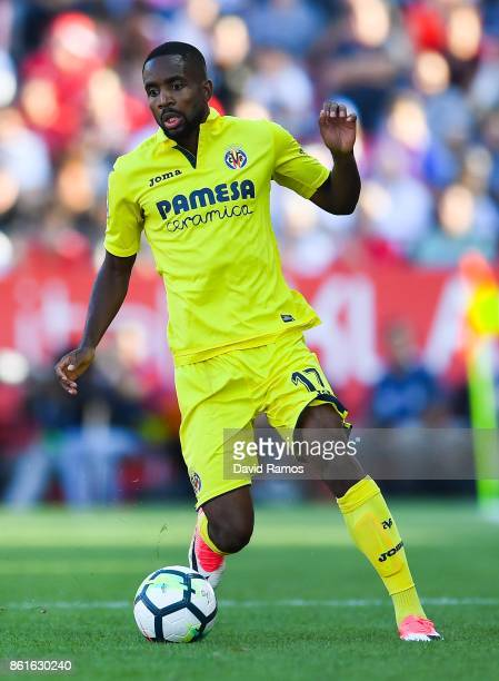 Cedric Bakambu of Villarreal CF runs with the ball during the La Liga match between Girona and Villarreal at Estadi de Montilivi on October 15 2017...