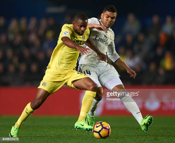 Cedric Bakambu of Villarreal competes for the ball with Casemiro of Real Madrid during the La Liga match between Villarreal CF and Real Madrid at...