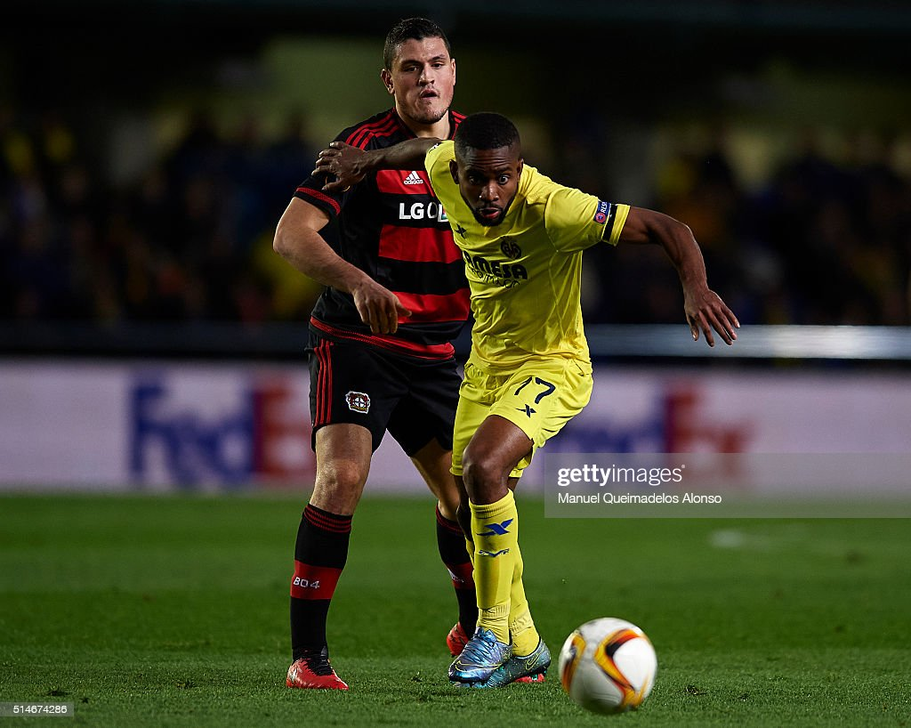 Cedric Bakambu (17) of Villarreal competes for the ball with Kyriakos ...