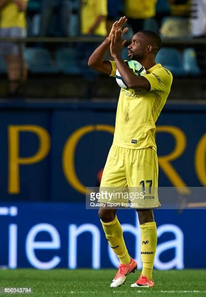 Cedric Bakambu of Villarreal holds the ball after score a hat trick at the La Liga match between Villarreal and Eibar at Estadio De La Ceramica on...
