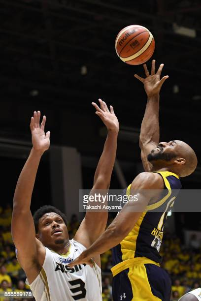 Cedric Bozeman of the Tochigi Brex shoots while under pressure from Daniel Orton of the SeaHorse Mikawa during the BLeague game between Tochigi Brex...