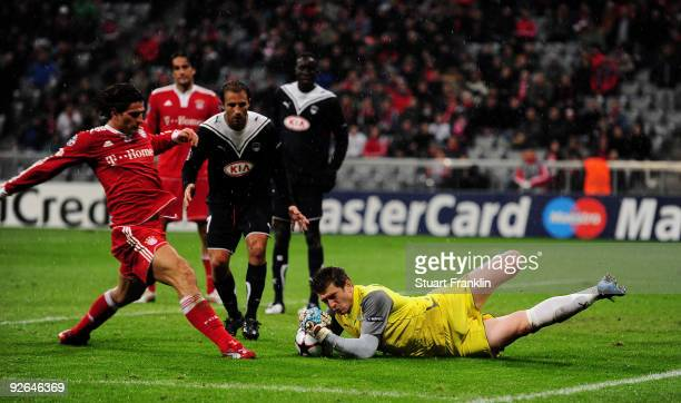 Cedric Carrasso of Bordeaux makes a save from Mario Gomez of Bayern during the UEFA Champions League Group A match between FC Bayern Muenchen and...