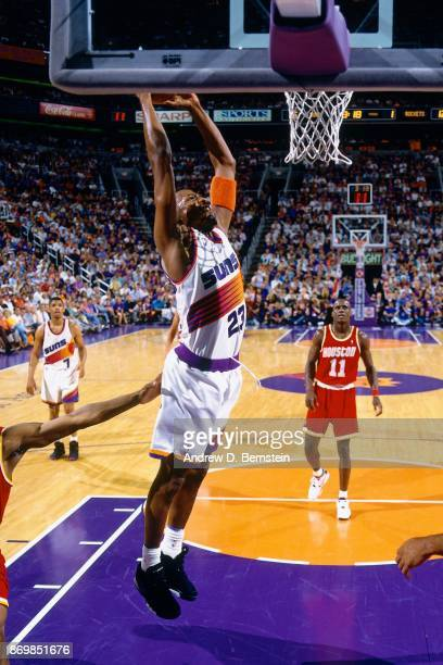 Cedric Ceballos of the Phoenix Suns dunks against the Houston Rockets during Game Three of the Western Conference Semifinals played on May 13 1994 at...