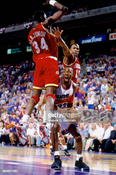 Cedric Ceballos of the Phoenix Suns shoots against Hakeem Olajuwon of the Houston Rockets during Game Three of the Western Conference Semifinals...