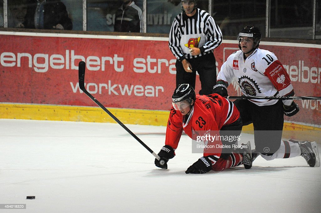 #23 Cedric Di Dio Balsamo of Briancon Diables Rouges is challenged by Mattias Janmark of Frolunda Gothenburg during the Champions Hockey League group stage game between Briancon Diables Rouges and Frolunda Gothenburg on August 23, 2014 in Briancon, France.