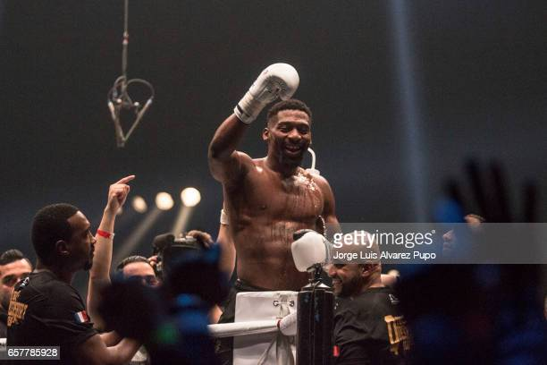 Cedric Doumced of France celebrates his victory over Yoann Kongolo of Switzerland during a Welterweight Glory kickboxing title fight at Forest...