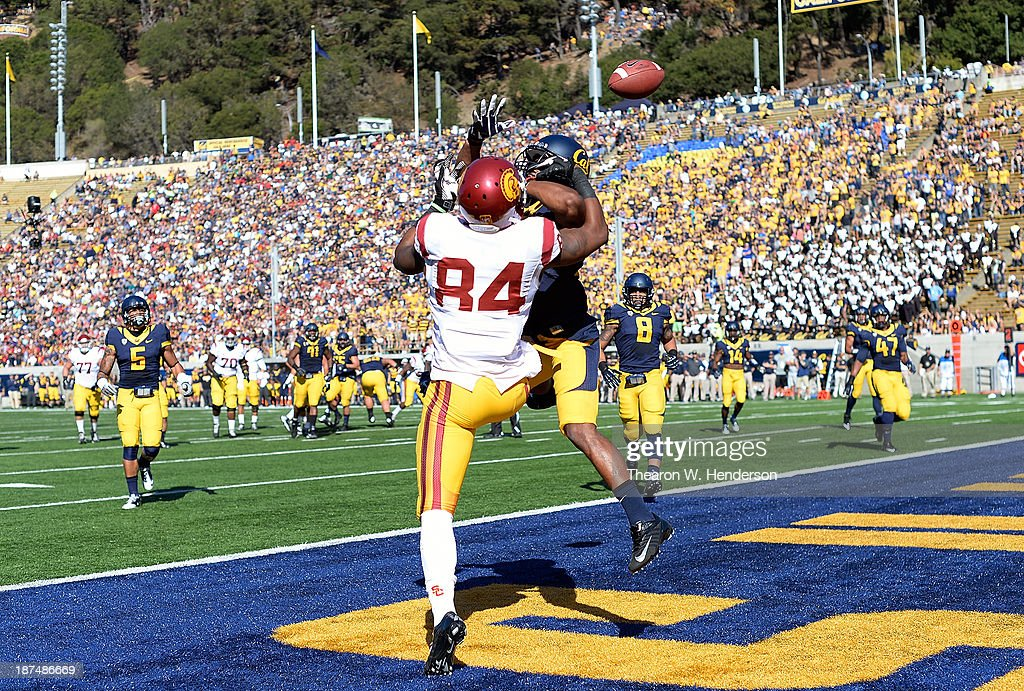 Cedric Dozier #37 of the California Golden Bears breaks up this pass in the endzone to Darreus Rogers #84 of the USC Trojans during the first quarter at California Memorial Stadium on November 9, 2013 in Berkeley, California.