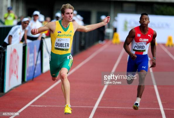 Cedric Dubler of Australia crosses the finish line in a preliminary heat of the 100 meter portion of the men's decathlon during day one of the IAAF...
