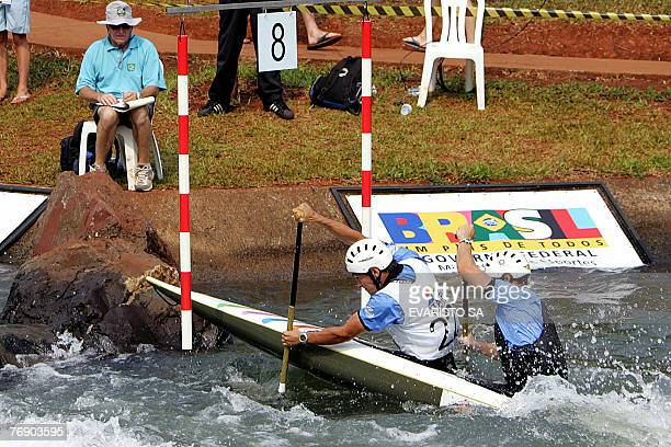Cedric Forgit and Martin Braud from France paddle during the men's C2 qualifiers of the 2007 Slalom World Championships at the Itaipu Hydroelectric...