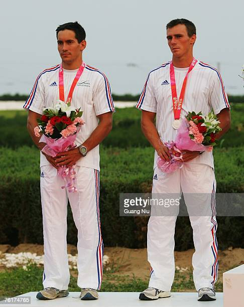 Cedric Forgit and Martin Braud of France celebrate during an award ceremony for the men's double Canoe Slalom Racing during day four of the Good Luck...