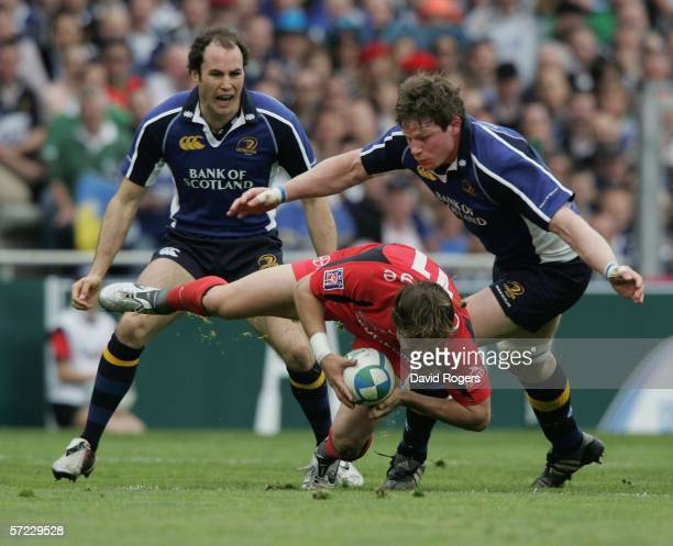 Cedric Heymans of Toulouse is tackled by Malcolm O'Kelly during the Heineken Cup match between Toulouse and Leinster at Stade Municipal on April 1...