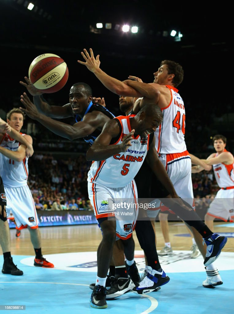 Cedric Jackson of the Breakers attempts to gather the loose ball during the round 11 NBL match between the New Zealand Breakers and the Cairns Taipans at Vector Arena on December 13, 2012 in Auckland, New Zealand.