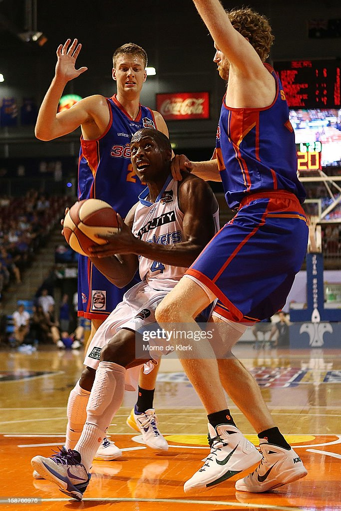 Cedric Jackson of the Breakers gets past Daniel Johnson and <a gi-track='captionPersonalityLinkClicked' href=/galleries/search?phrase=Luke+Schenscher&family=editorial&specificpeople=207134 ng-click='$event.stopPropagation()'>Luke Schenscher</a> of the 36ers during the round 12 NBL match between the Adelaide 36ers and the New Zealand Breakers at Adelaide Arena on December 28, 2012 in Adelaide, Australia.