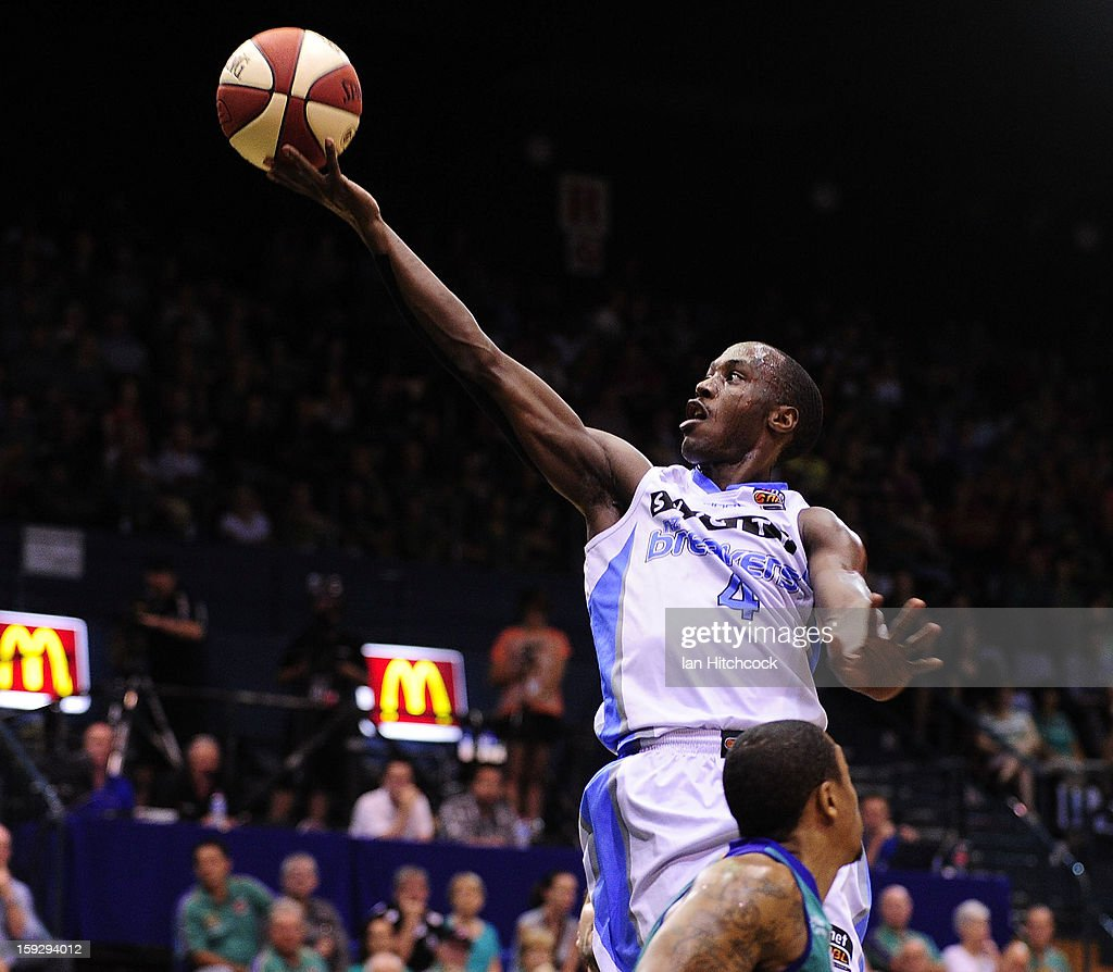 Cedric Jackson of the Breakers leaps over Gary Ervin of the Crocodiles during the round 14 NBL match between the Townsville Crocodiles and the New Zealand Breakers at Townsville Entertainment Centre on January 11, 2013 in Townsville, Australia.