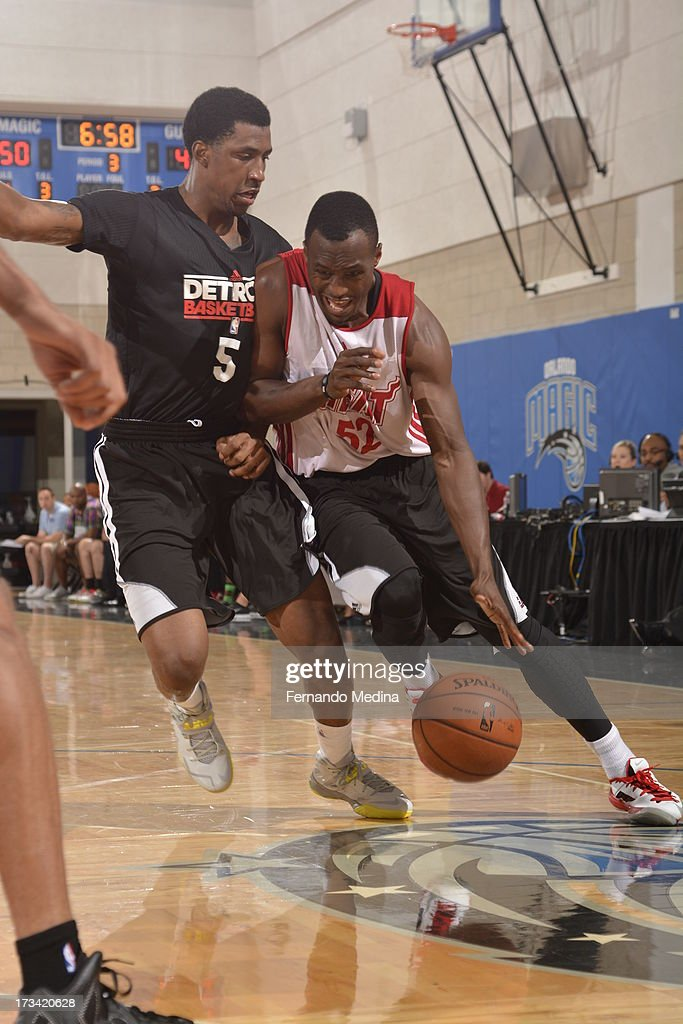 Cedric Jackson #52 of the Miami Heat drives against Kentavious Caldwell-Pope #5 of the Detroit Pistons during the 2013 Southwest Airlines Orlando Pro Summer League between the Detroit Pistons and the Miami Heat on July 12, 2013 at Amway Center in Orlando, Florida.