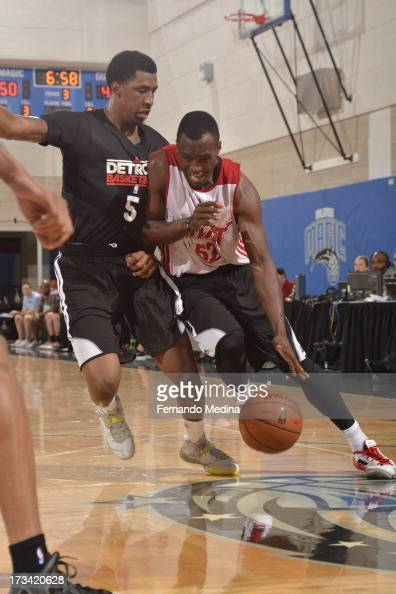 Cedric Jackson of the Miami Heat drives against Kentavious CaldwellPope of the Detroit Pistons during the 2013 Southwest Airlines Orlando Pro Summer...