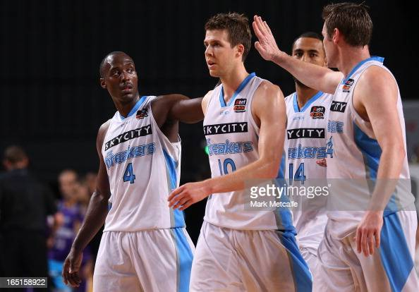 Cedric Jackson Thomas Abercrombie and Dillon Boucher of the Breakers celebrate victory at the end of game two of the NBL Semi Final series between...