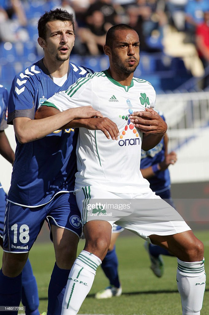<a gi-track='captionPersonalityLinkClicked' href=/galleries/search?phrase=Cedric+Kante&family=editorial&specificpeople=648441 ng-click='$event.stopPropagation()'>Cedric Kante</a> (R) of Panathinaikos FC and Konstantinos Giannoulis of Atromitos FC look on during the Greek Super League match between Atromitos FC and Panathinaikos FC held on May 16, 2012 at the Peristeri Stadium in Athens, Greece.
