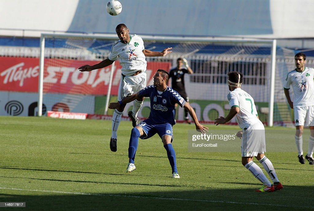 <a gi-track='captionPersonalityLinkClicked' href=/galleries/search?phrase=Cedric+Kante&family=editorial&specificpeople=648441 ng-click='$event.stopPropagation()'>Cedric Kante</a> (R) of Panathinaikos FC rises above Anastasios Karamanos of Atromitos FC during the Greek Super League match between Atromitos FC and Panathinaikos FC held on May 16, 2012 at the Peristeri Stadium in Athens, Greece.