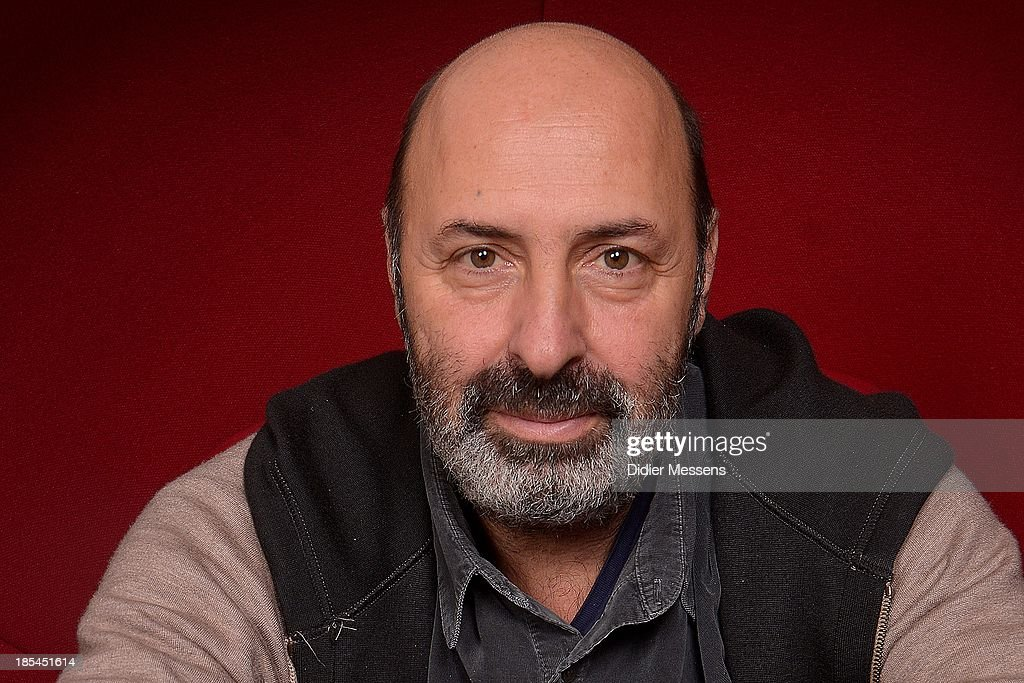 Cedric Klapisch poses for a photoshoot at the 40th Ghent Film Festival on October 18, 2013 in Gent, Belgium.