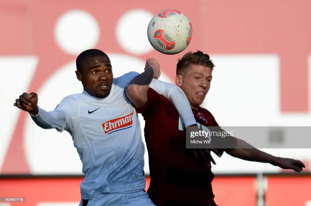 Cedric Makiadi (L) of Freiburg is challenged by Mike Frantz of Nuernberg during the Bundesliga Match between 1. FC Nuernberg and SC Freibug at Grundig Stadion on March 2, 2013 in Nuremberg, Germany.