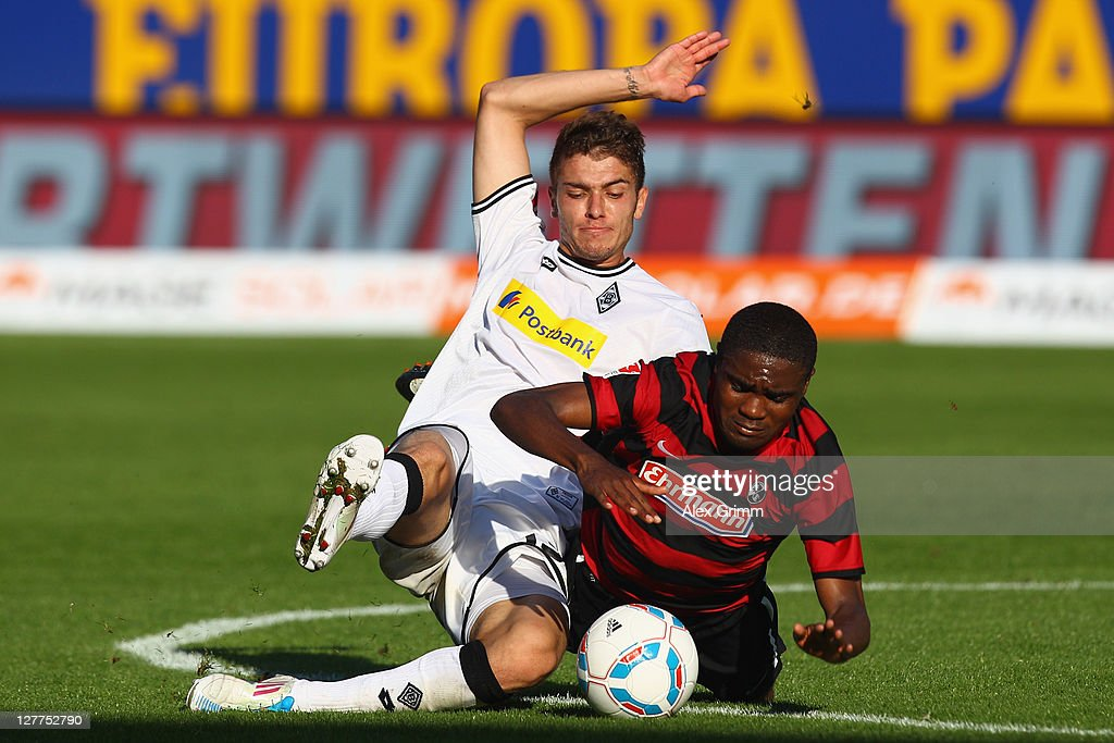 Cedric Makiadi (Sebastian Hofmann of Freiburg is challenged by <a gi-track='captionPersonalityLinkClicked' href=/galleries/search?phrase=Roman+Neustaedter&family=editorial&specificpeople=5437402 ng-click='$event.stopPropagation()'>Roman Neustaedter</a> of Moenchengladbach during the Bundesliga match between SC Freiburg and Borussia Moenchengladbach at Badenova Stadium on October 1, 2011 in Freiburg im Breisgau, Germany.