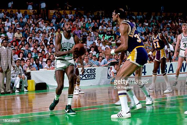 Cedric Maxwell of the Boston Celtics drives to the basket against Kareem AbdulJabbar of the Los Angeles Lakers during a game circa 1984 at the Boston...