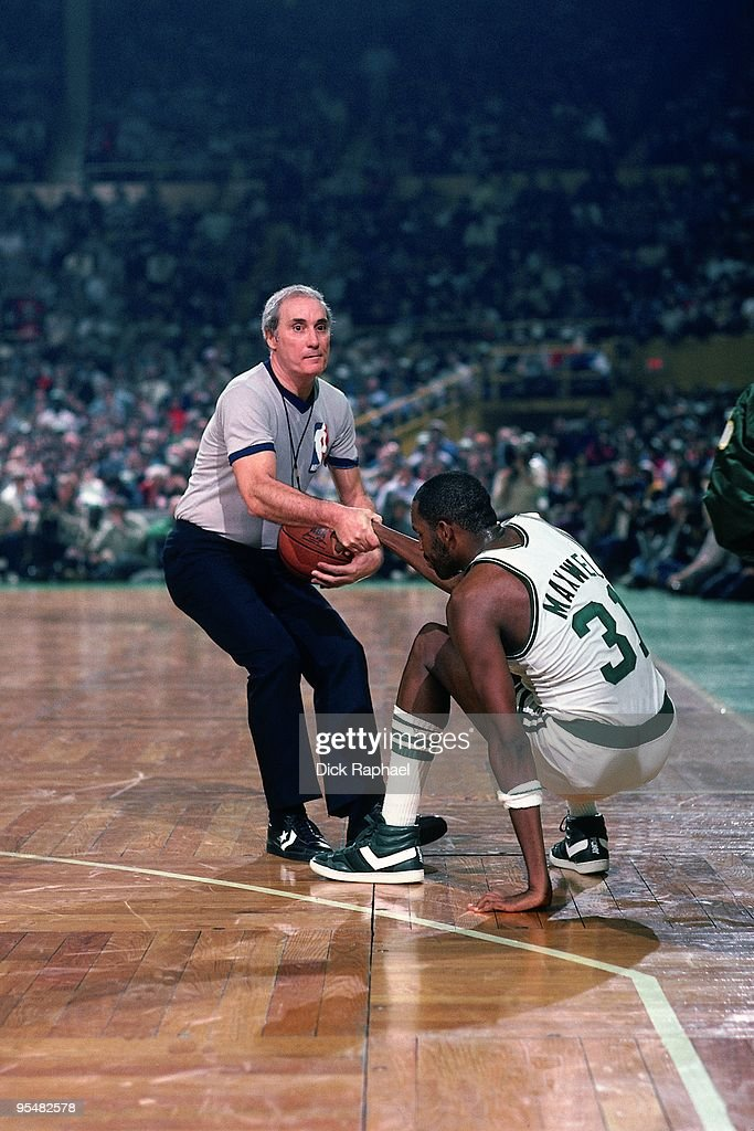 <a gi-track='captionPersonalityLinkClicked' href=/galleries/search?phrase=Cedric+Maxwell&family=editorial&specificpeople=2105758 ng-click='$event.stopPropagation()'>Cedric Maxwell</a> #31 of the Boston Celtics is helped off the floor by a referee during a game played in 1984 at the Boston Garden in Boston, Massachusetts.