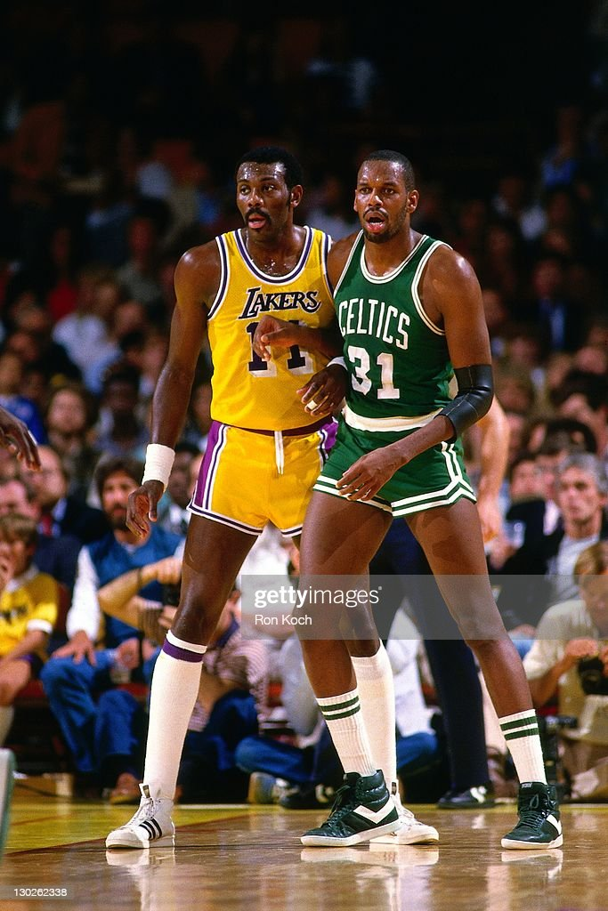 <a gi-track='captionPersonalityLinkClicked' href=/galleries/search?phrase=Cedric+Maxwell&family=editorial&specificpeople=2105758 ng-click='$event.stopPropagation()'>Cedric Maxwell</a> #31 of the Boston Celtics posts up against <a gi-track='captionPersonalityLinkClicked' href=/galleries/search?phrase=Bob+McAdoo&family=editorial&specificpeople=221416 ng-click='$event.stopPropagation()'>Bob McAdoo</a> #11 of the Los Angeles Lakers during a game played circa 1985 at the Great Western Forum in Inglewood, California.