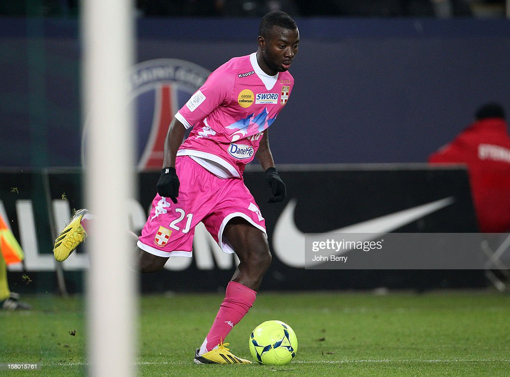 <a gi-track='captionPersonalityLinkClicked' href=/galleries/search?phrase=Cedric+Mongongu&family=editorial&specificpeople=4305033 ng-click='$event.stopPropagation()'>Cedric Mongongu</a> of Evian TG in action during the French Ligue 1 match between Paris Saint Germain FC and Evian Thonon Gaillard FC at the Parc des Princes stadium on December 8, 2012 in Paris, France.