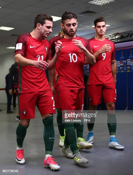 Cedric of Portugal and Bernardo Silva of Portugal speak as they walk out for the second half during the FIFA Confederations Cup Russia 2017 SemiFinal...
