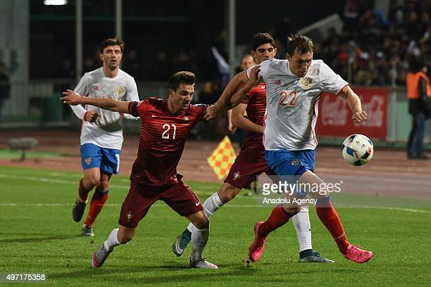 Cedric of Portugal and Dzyuba of Russia contest the ball during the friendly match between Russia and Portugal at Kuban Stadium in Krasnodar Russia...
