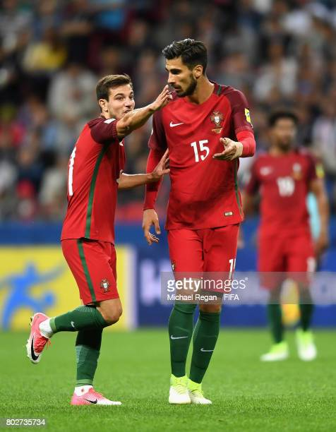 Cedric of Portugal speaks with Andre Gomes of Portugal during the FIFA Confederations Cup Russia 2017 SemiFinal between Portugal and Chile at Kazan...