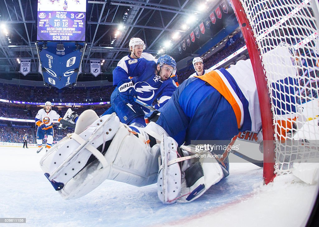 <a gi-track='captionPersonalityLinkClicked' href=/galleries/search?phrase=Cedric+Paquette&family=editorial&specificpeople=9491385 ng-click='$event.stopPropagation()'>Cedric Paquette</a> #13 of the Tampa Bay Lightning battles for the puck against goalie <a gi-track='captionPersonalityLinkClicked' href=/galleries/search?phrase=Thomas+Greiss&family=editorial&specificpeople=695275 ng-click='$event.stopPropagation()'>Thomas Greiss</a> #1 of the New York Islanders during the second period of Game Two of the Eastern Conference Second Round in the 2016 NHL Stanley Cup Playoffs at the Amalie Arena on April 30, 2016 in Tampa, Florida.
