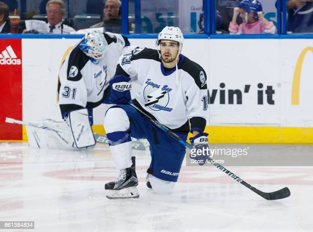 Cedric Paquette of the Tampa Bay Lightning dons a 199293 home jersey for pregame warm ups against the St Louis Blues at Amalie Arena on October 14...