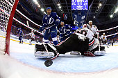 Cedric Paquette of the Tampa Bay Lightning scores a first period goal against Corey Crawford of the Chicago Blackhawks during Game Two of the 2015...