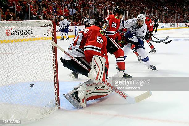 Cedric Paquette of the Tampa Bay Lightning scores a goal in the third period against Corey Crawford of the Chicago Blackhawks during Game Three of...