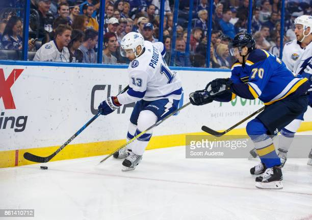 Cedric Paquette of the Tampa Bay Lightning skates against Oskar Sundqvist of the St Louis Blues during the third period at Amalie Arena on October 14...