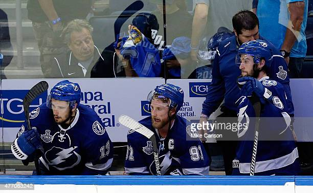 Cedric Paquette Steven Stamkos and Tyler Johnson of the Tampa Bay Lightning look on from the bench during the third period in Game Five of the 2015...