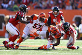 Cedric Peerman of the Cincinnati Bengals recovers an onside kick before Kroy Biermann of the Atlanta Falcons is able to cover up the ball during the...