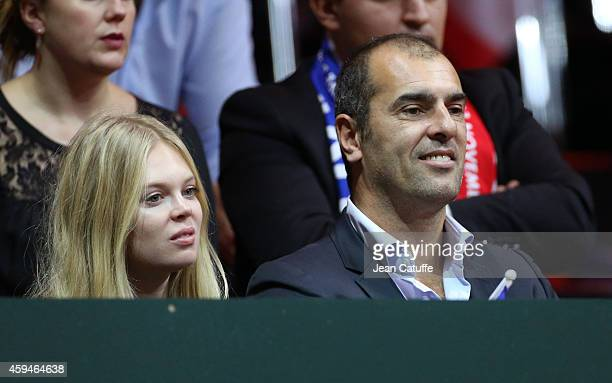 Cedric Pioline and his girlfriend attend day three of the Davis Cup tennis final between France and Switzerland at the Grand Stade Pierre Mauroy on...