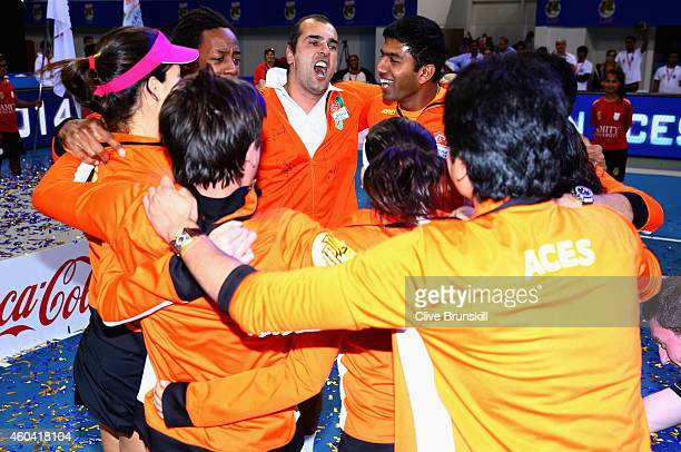 Cedric Pioline celebrates with his team mates Fabrice SantoroAna IvanovicGael MonfilsSania Mirza and Rohan Bopanna of the Indian Aces after becoming...