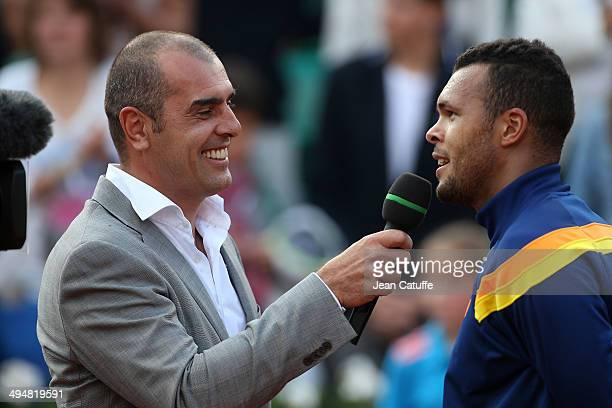 Cedric Pioline interviews JoWilfried Tsonga after his victory on Day 6 of the French Open 2014 held at RolandGarros stadium on May 30 2014 in Paris...