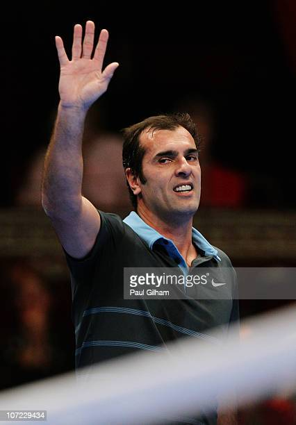 Cedric Pioline of France celebrates winning the match between Cedric Pioline and Greg Rusedski on day two of the AEGON Masters 2010 at the Royal...