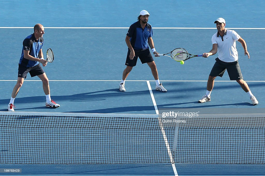 Cedric Pioline of France, Guy Forget of France, and Henri Leconte of France compete in their fourth round legends doubles match during day seven of the 2013 Australian Open at Melbourne Park on January 20, 2013 in Melbourne, Australia.