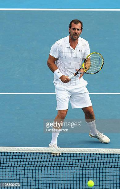 Cedric Pioline of France plays a forehand in his round two match with Mansour Bahrami of Iran against Jacco Eltingh and Paul Haarhuis of the...