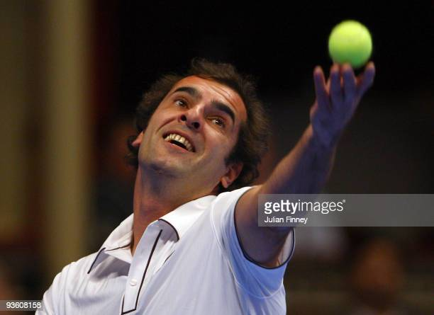 Cedric Pioline of France serves to Pat Rafter of Australia during day two of the AEGON Masters Tennis at the Royal Albert Hall on December 2 2009 in...