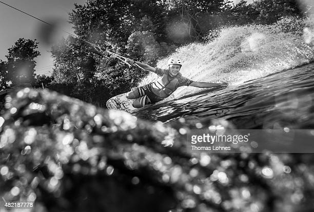 Cedric Schmidt performs with the Kneeboard during a training session at 'Hotspot Seepark' on July 27 2015 in Niederweimar Germany
