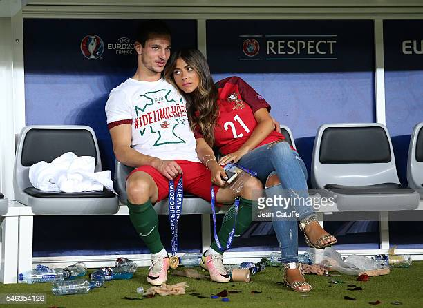 Cedric Soares and Filipa Brandao celebrate the victory following the UEFA Euro 2016 final between Portugal and France at Stade de France on July 10...
